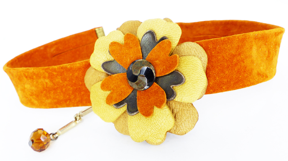 Shown above with one of our interchangeable Leather magnetic Mag TAK flowers.