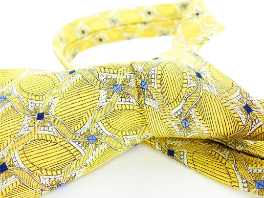 Pale lemon yellow with little navy and baby blue diamond details. Designer ties like Nordstrom & Robert Talbott.