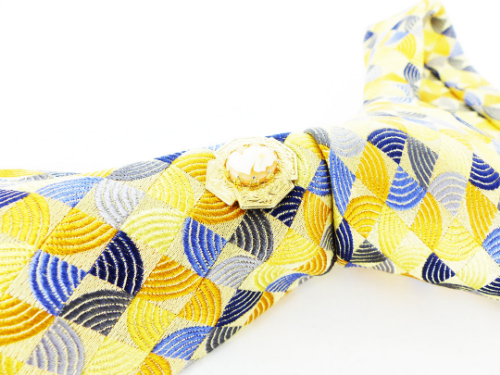 Woven silk, XMI Platinmum. Butter yellow and navy geometric necktie, show with a cameo MagTAK, magnetic tie tack.