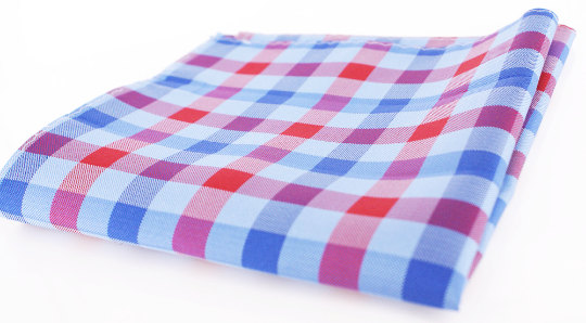 Fresh preppy woven silk pocket square in baby blue and red checkered pattern.