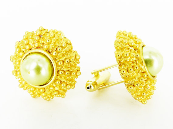 Handcrafted Women's cufflinks in both of our stores. Mint pearl Sea Urchins set in gold.