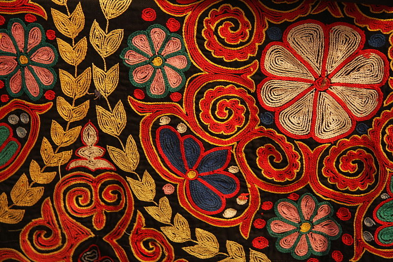 Traditional embroidery in chain stitch on a Kazakh rug, contemporary