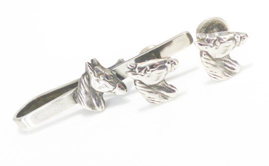 Vintage Silver horse head tie bar and cufflink set . Marked. Forged metal, Gorgeous set to add to your collection.  Polished up with Renaissance wax to give them a gorgeous luster and protect them from the elements.