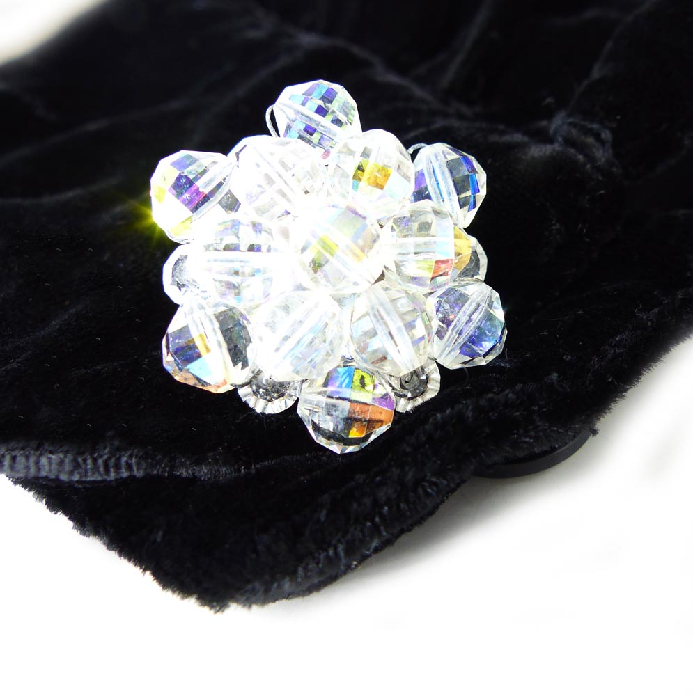 Iridescent clear crystal cluster women's cufflinks. Shown on a black velvet blouse.
