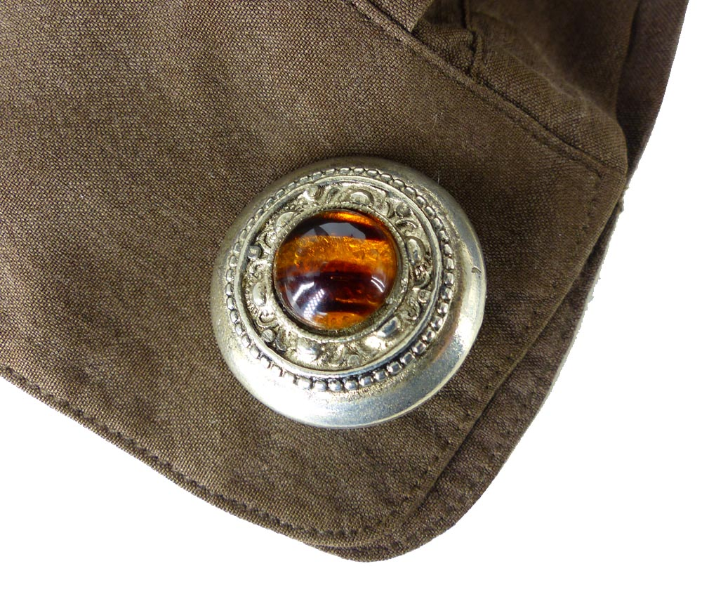 Casual western tortoise and silver ladies cufflinks shown with a soft cotton blouse. Upgraded casual office look with jeans