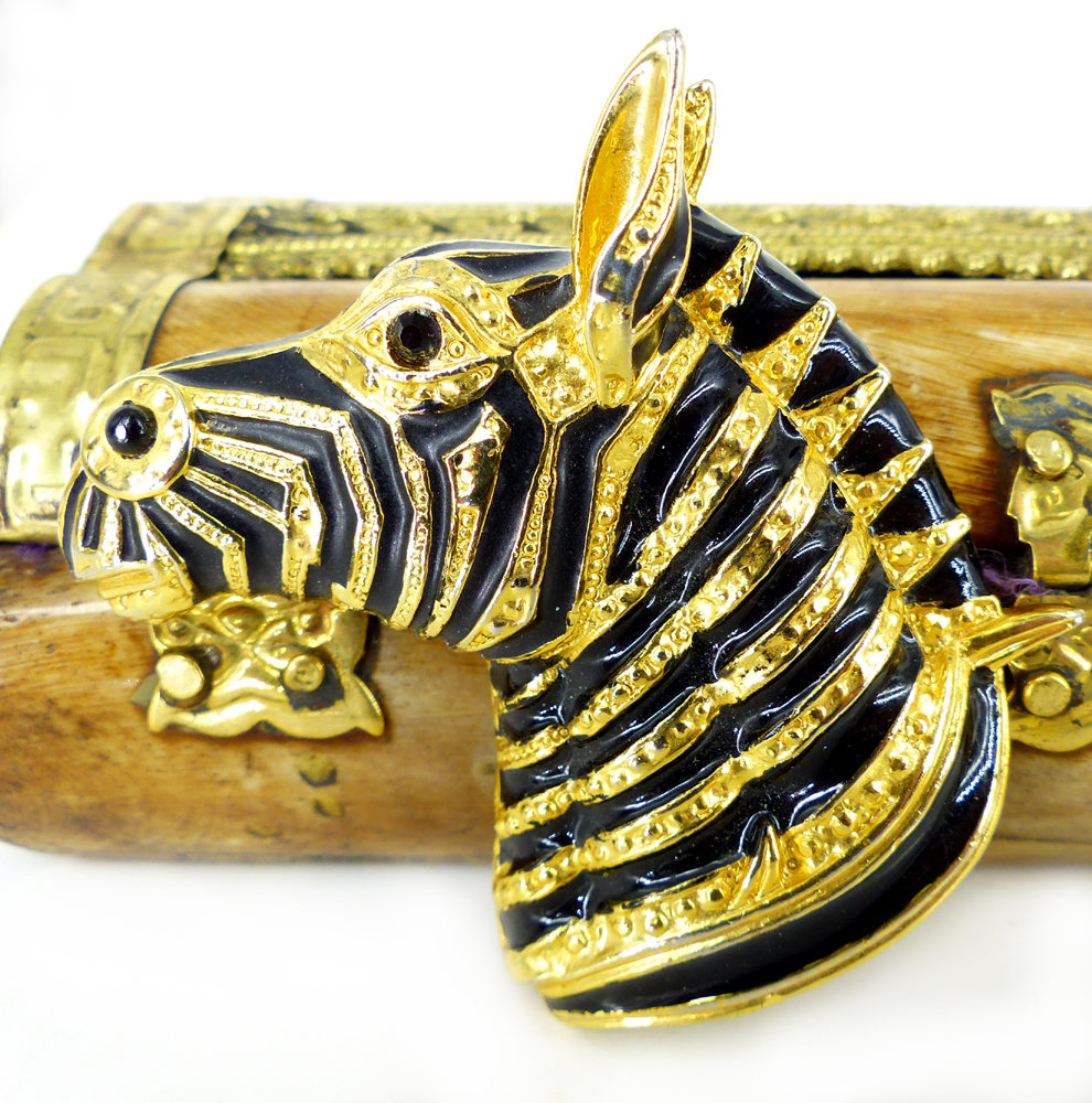 Statement brooch. Bold and impressive gold and black zebra head brooch or lapel pin. Excellent condition with patch pin closure.