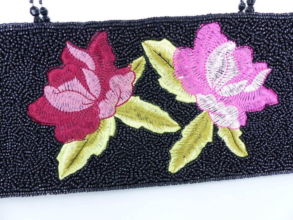 L. Erickson Black seed beaded purse with embroidered blooming roses in red & pink. Beaded wire handles.