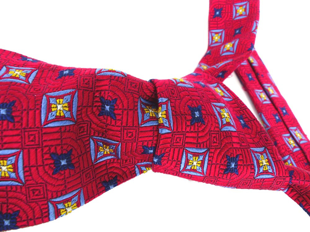 Robert Talbott Best of Class thick woven silk necktie. Scarlet red with medallions in yellow gold and baby blue. Beautiful woven silk design
