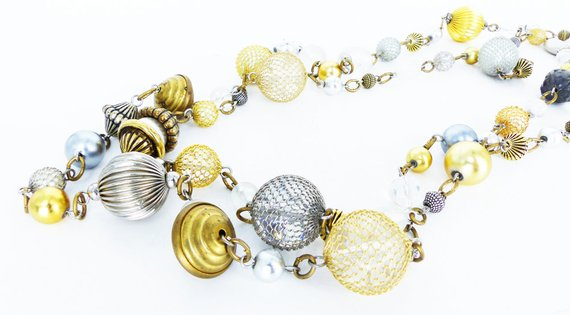 Bauble extra long strand necklace. Metal mesh covered beads in silver and gold