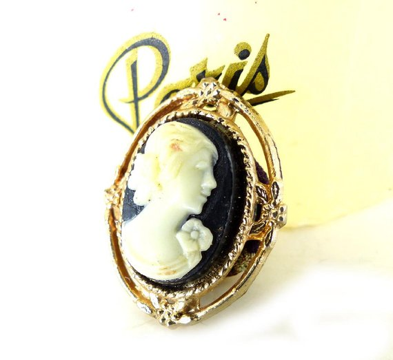 Vintage black & cream profile cameo with rose magnetic brooch set in an open gold floral frame