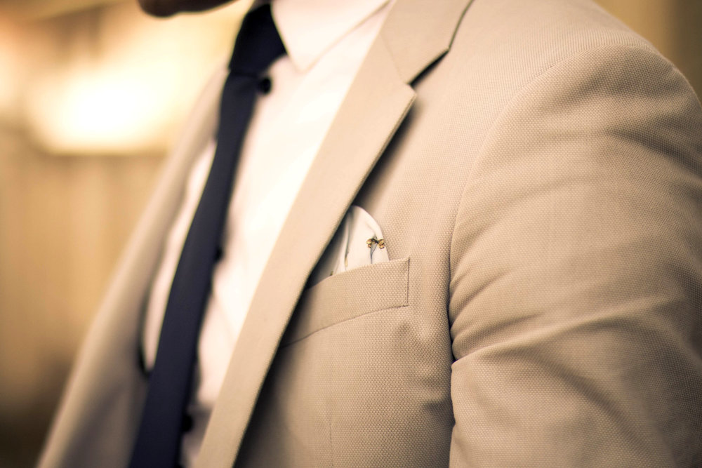 Summer light suits - With light colored suits, a subtle pocket square is a good choice, having interesting details, draws in the eye.