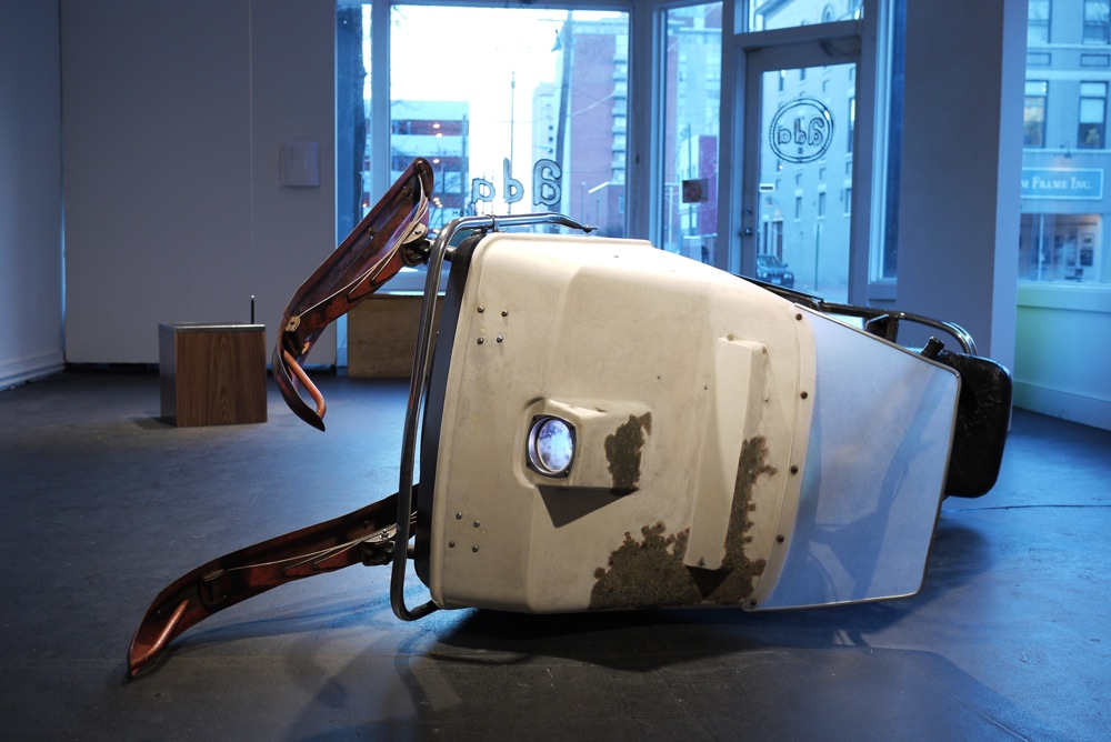 """Horse With No Name, 2010, 3'X4""""x8', restored 1970 Johnson Skee Horse, fabricated seat and windshield, color pencil, wax, hardware with patina, digital projection of a photograph of the sun behind clouds"""