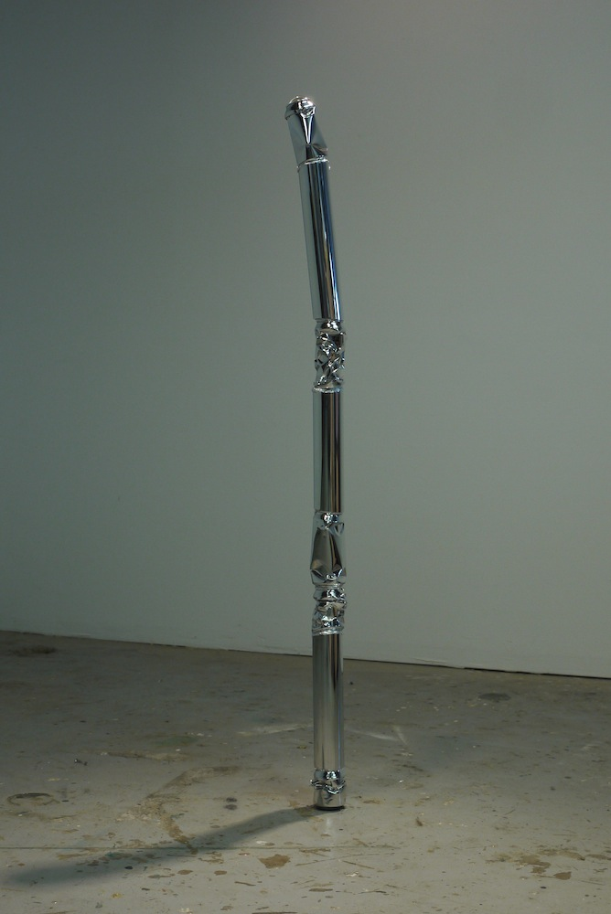 "Wizard's Staff, 2013, 3""x3""x49"", high-­‐polished Budweiser cans, high-­‐polished aluminum pipe, steel, Bondo, silver leaf, felt, lens, iguana skull fragment"