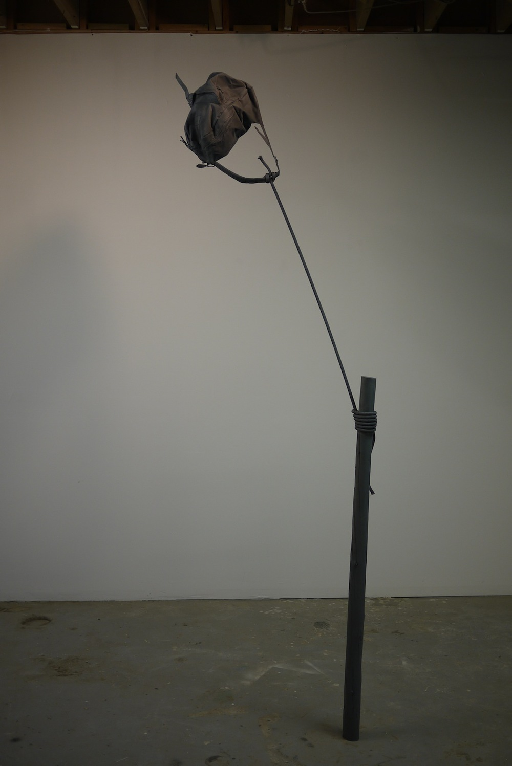 "Time Alone, 2014, 106""x22""x4'' , wood, steel, backpack, rope, paint"