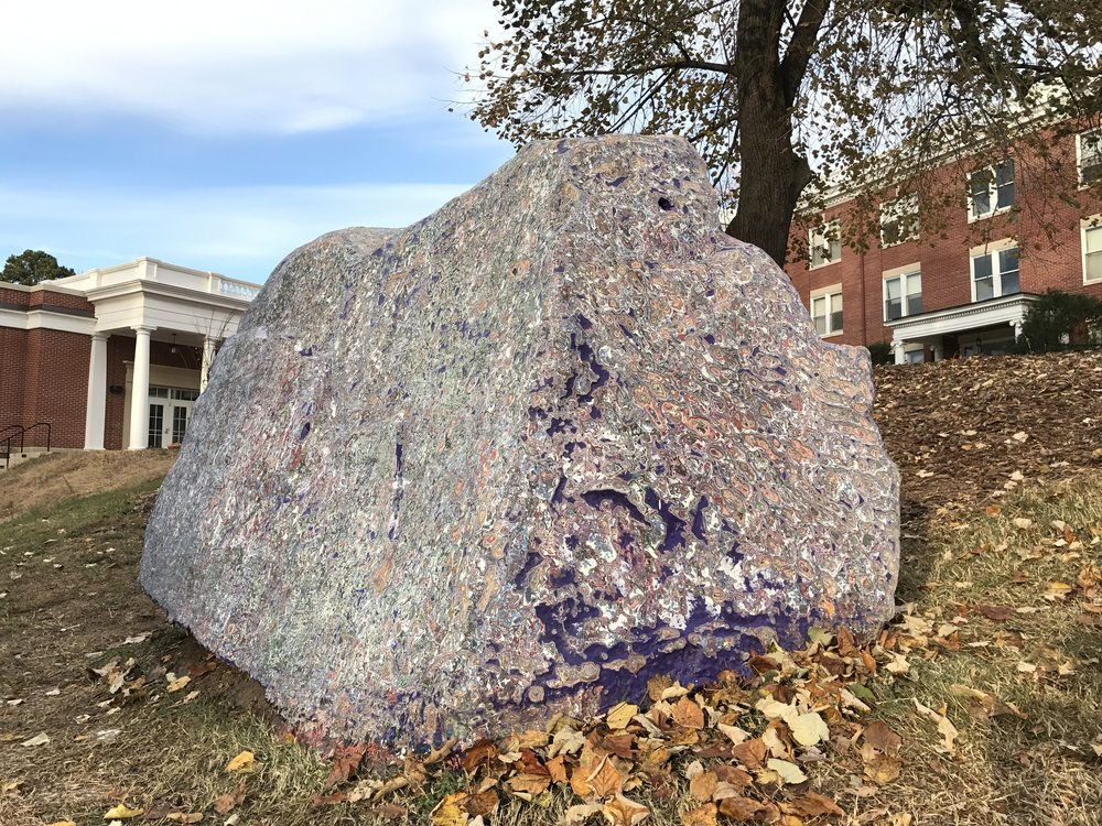 Spirit Rock, 2016, granite boulder, paint, 4.5' x 5.5' x 10'   Spirit Rocks are a common public forum at many universities and represent a sort of violence against geology. In order to disrupt the cycle of messages painted on the rock throughout the semester, I decided to strip paint from the Spirit Rock at University of Mary Washington, where I'm an adjunct instructor. The project gives a voice the strange materiality of the rock, a true geologic oddity of the anthropocene.