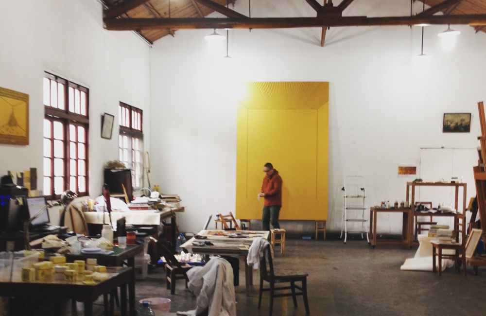 Ni Youyu working in his studio in Shanghai, 2013     Photo: Shasha Liu