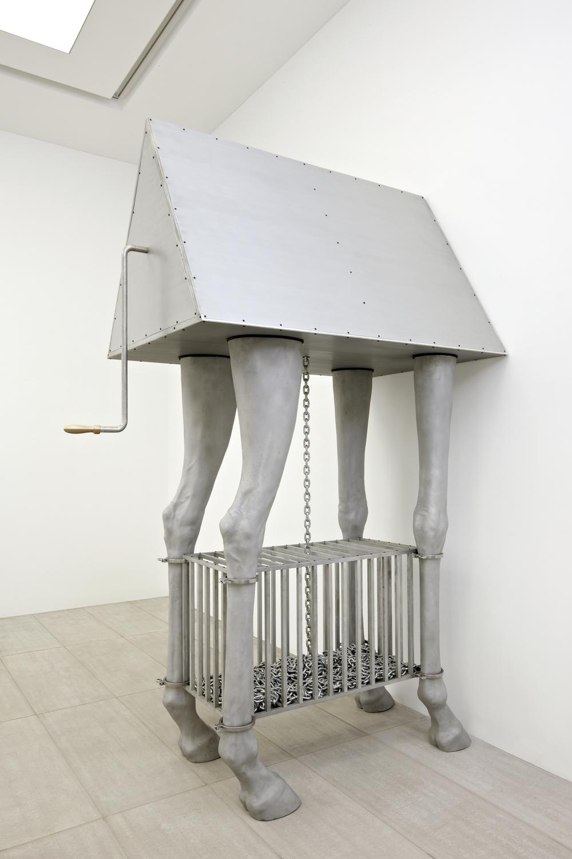 Gao Lei 高磊, M-275, 2012, Aluminum triangle top, aluminum cage, aluminum giraffe legs sculpture, iron chains and copper handle 铝、不锈钢、黄铜、铁链, 330 x 180 x 120 cm