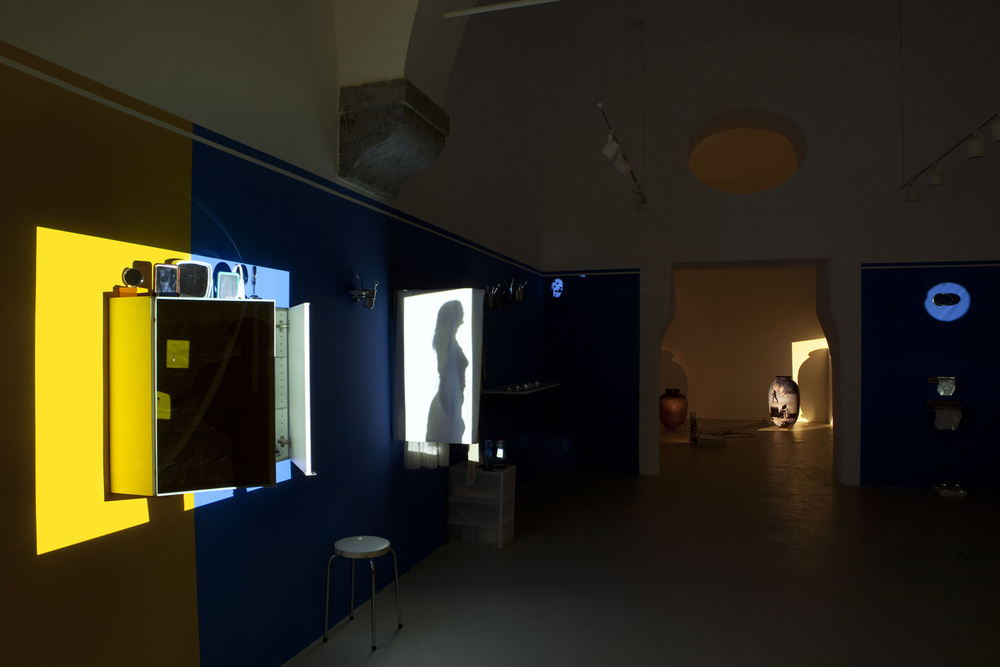 Mother and Father , 2012 Light installation with domestic products and single channel video projection, 08:00 min 8 x 2 x 2 m Edition of 3 +1 AP       installation view