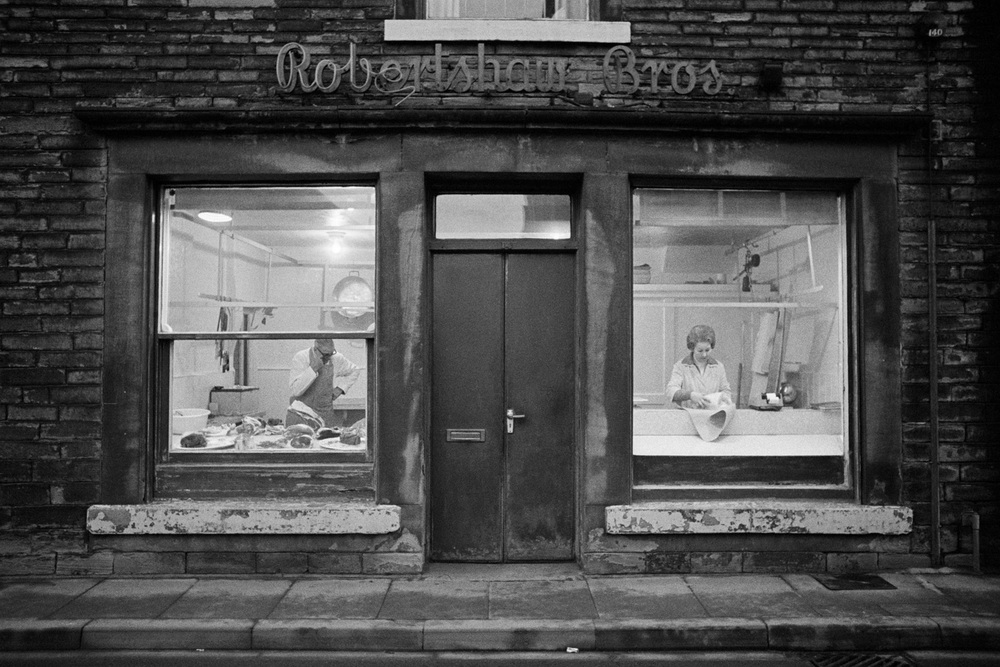 Great Britain, Yorkshire Mytholmroyd (Butchers' shop), 1977 gelatin silver print (printed 2010), 20.5 x 40 cm uneditioned