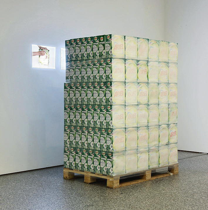 Eulalia Valldosera,  Envases borrados [forever living products] , 2008 Installation with packages of detergent handled, double video performance, photography