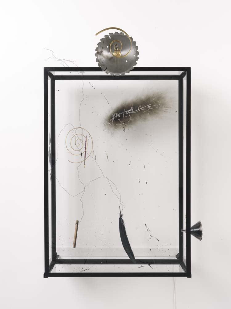 Rebecca Horn,  The Lost Ones, Samuel Beckett , 2015 steel, glass, glass surface treated with flaming, writing on the flaming glass surface, glass funnel, brush, saw blade, feather, wood, electronic device, brass, wire, cm 116x77x31