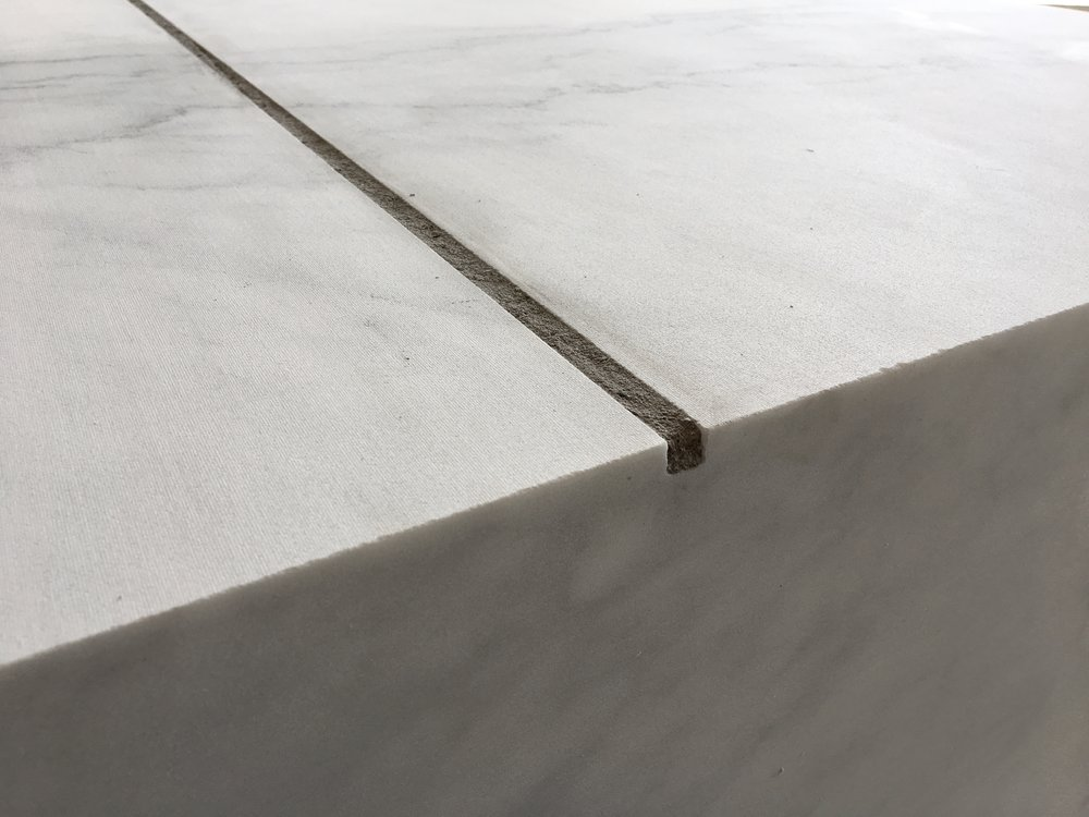 A Square Meter of Marble with a Linear Meter of Ash,  2018 marble, cigar ash, detail