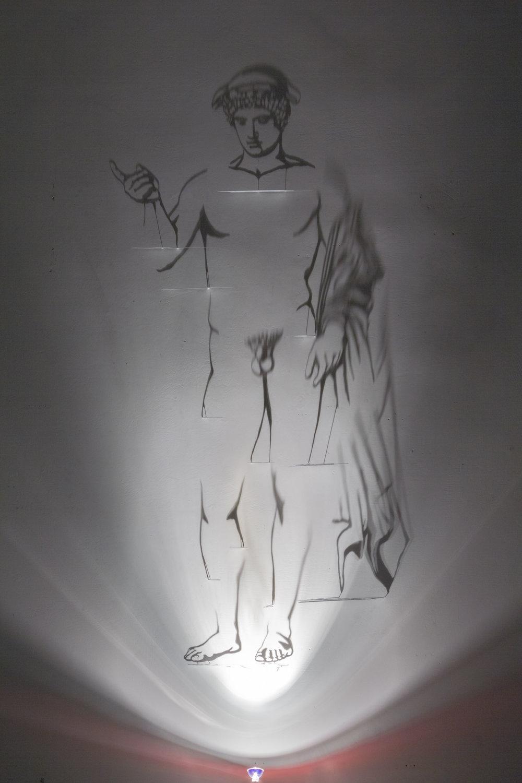 Hermes Ludovisi , 2015, ottone dipinto di bianco, alogena. ombre, immagine cm 215x95