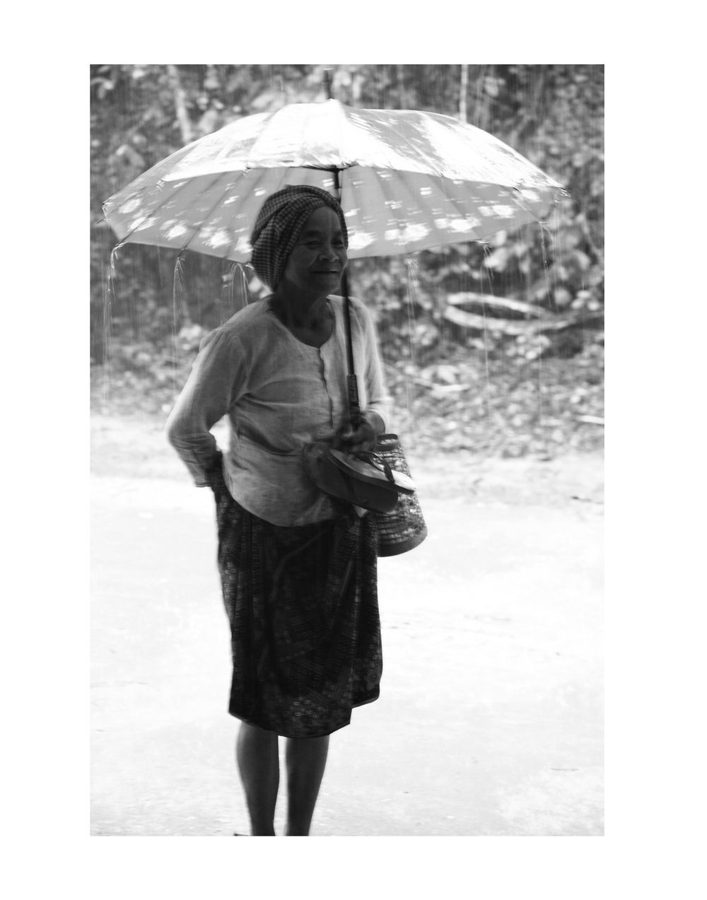 Cambodian Woman in the Rain Portfolio.jpg