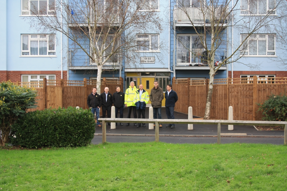 Cllr Anderson with officers and contractors outside one of the newly refurbished blocks