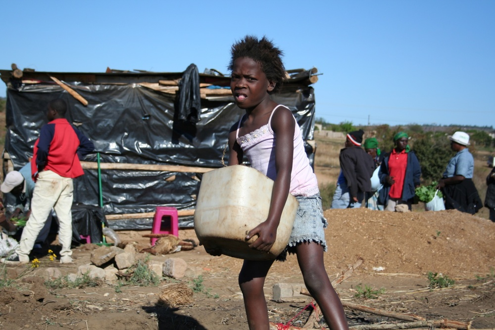Children were being taken out of school to collect water, with  little girls making up to 4 journeys per day like this.