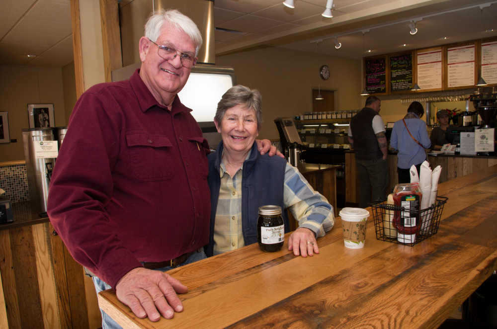 "SWEETHEARTS: Doug and Barbara Harrell, pictured at Green Sage Café Westgate, grow and process sorghum on their family farm in Bakersville. They and Green Sage owner Randy Talley are promoting what Talley calls the ""back-to-sorghum movement."" Photo by Cindy Kunst"
