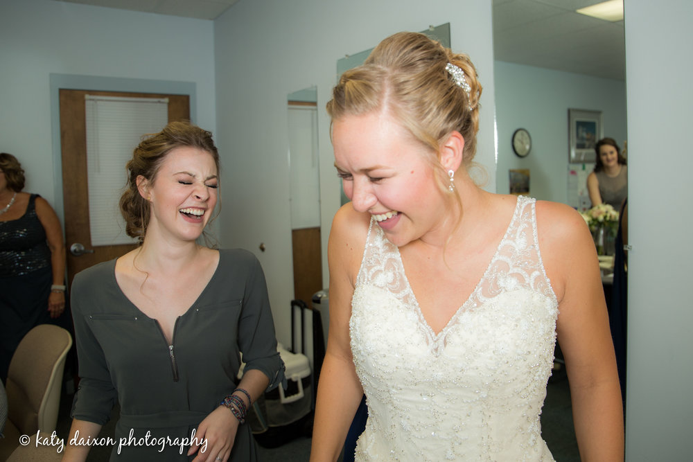 Pre-ceremony laughs as the bride finishes getting ready.