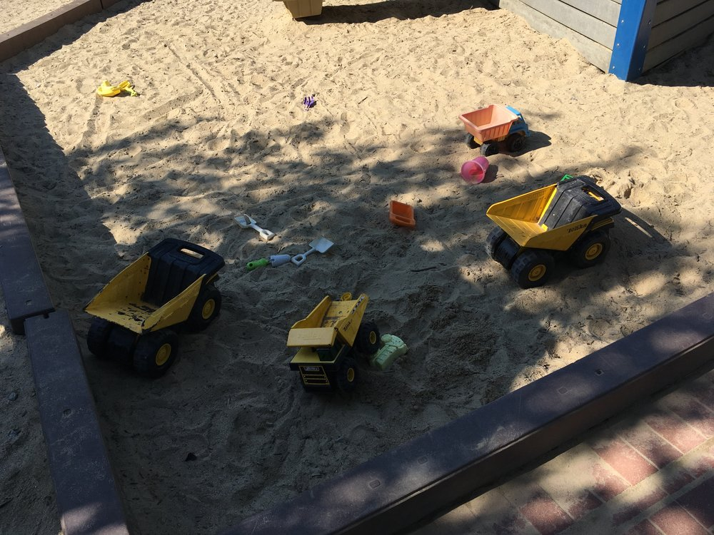 """High quality"" Tonka trucks in the sandbox, which was free of animal evidence... although the potential concerned reviewers."