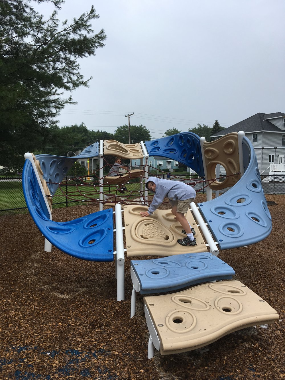 Jacob was mindful of his footing in the rain, but loved Highlands Community Playground.