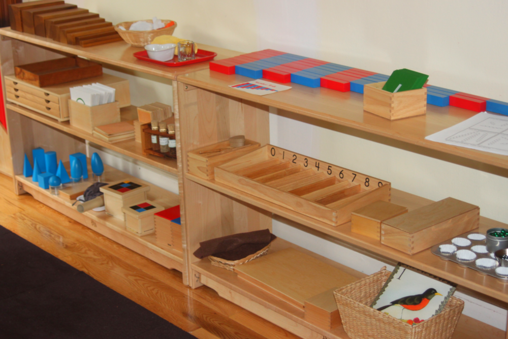Shelves with self-correcting Montessori learning materials
