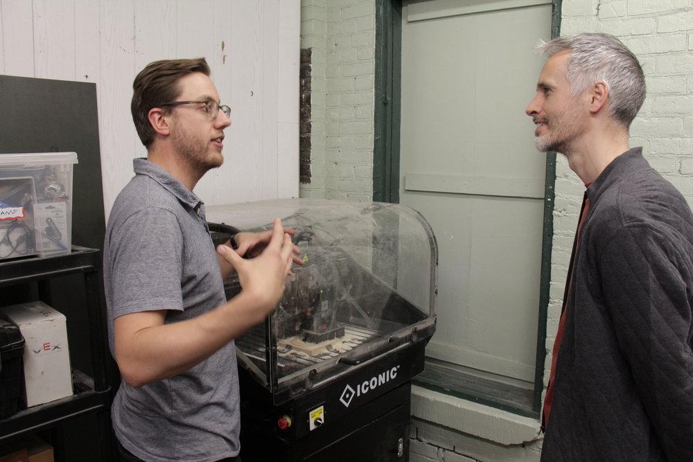 Titus Talking to Man about CNC.JPG