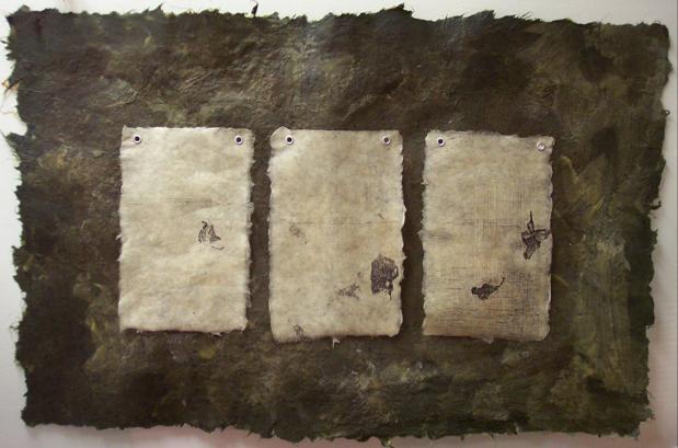 Icarus. 2003. Handmade paper, xerograph prints, encaustic. -