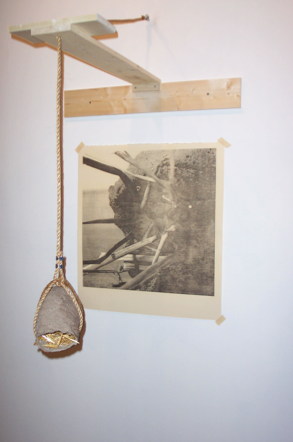 Introspection (detail). 2003. Transfer print, pine, mud, straw, rope, hardware. -