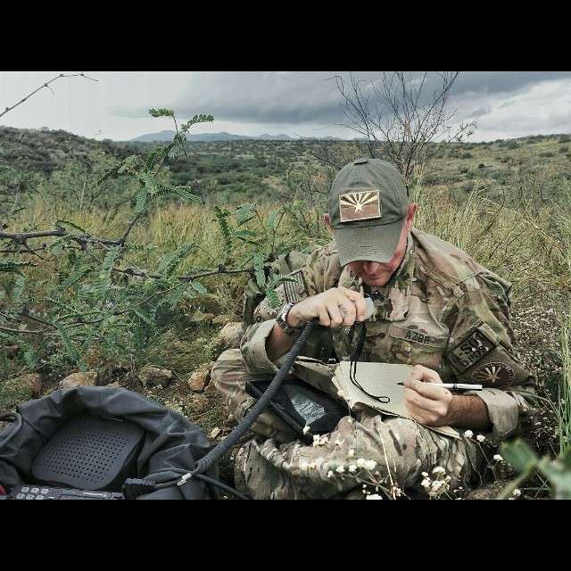 """""""SPARTAN"""" the communications officer for the Arizona Border Recon records the coordinates of Foxtrot team, less than a mile away. The AZBR is a militia style group who voluntarily patrols the Arizona Mexico border east of Sasabe."""