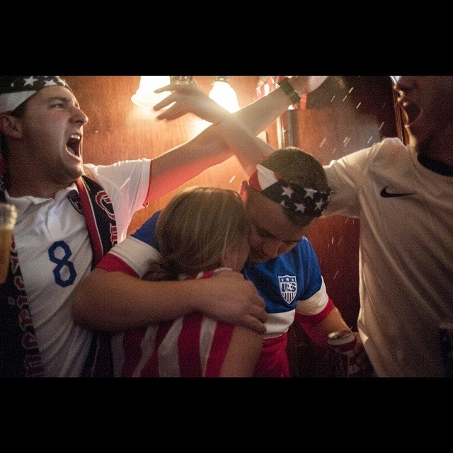 Fans celebrate the one and only US goal, coming in extra time, during their subsequent elimination game vs Belgium.