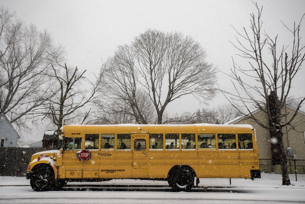 A school bus sits idly by as snow begins to fall early this afternoon.