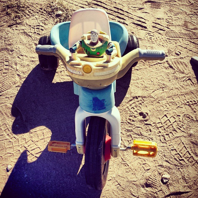 Buzz Lightyear drives a tricyle.