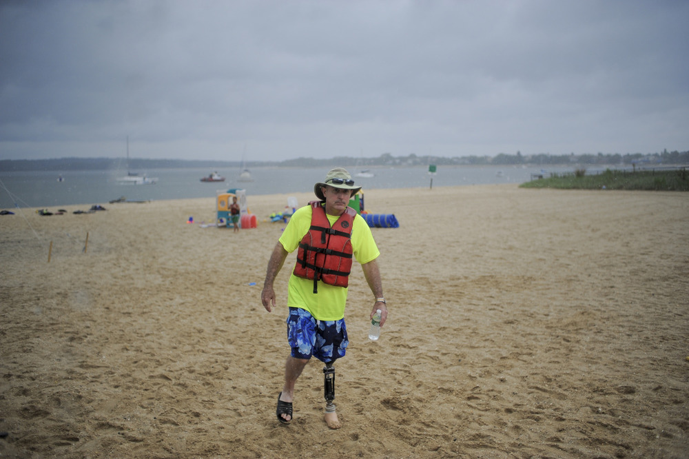 Vets participate in water sports and obstacle courses through the Wounded Warriors Program