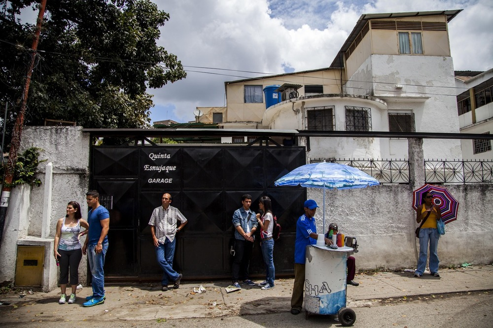 Voters await to cast their ballots outside of a polling area in Caracas, Venezuela.  ©Johnny Milano