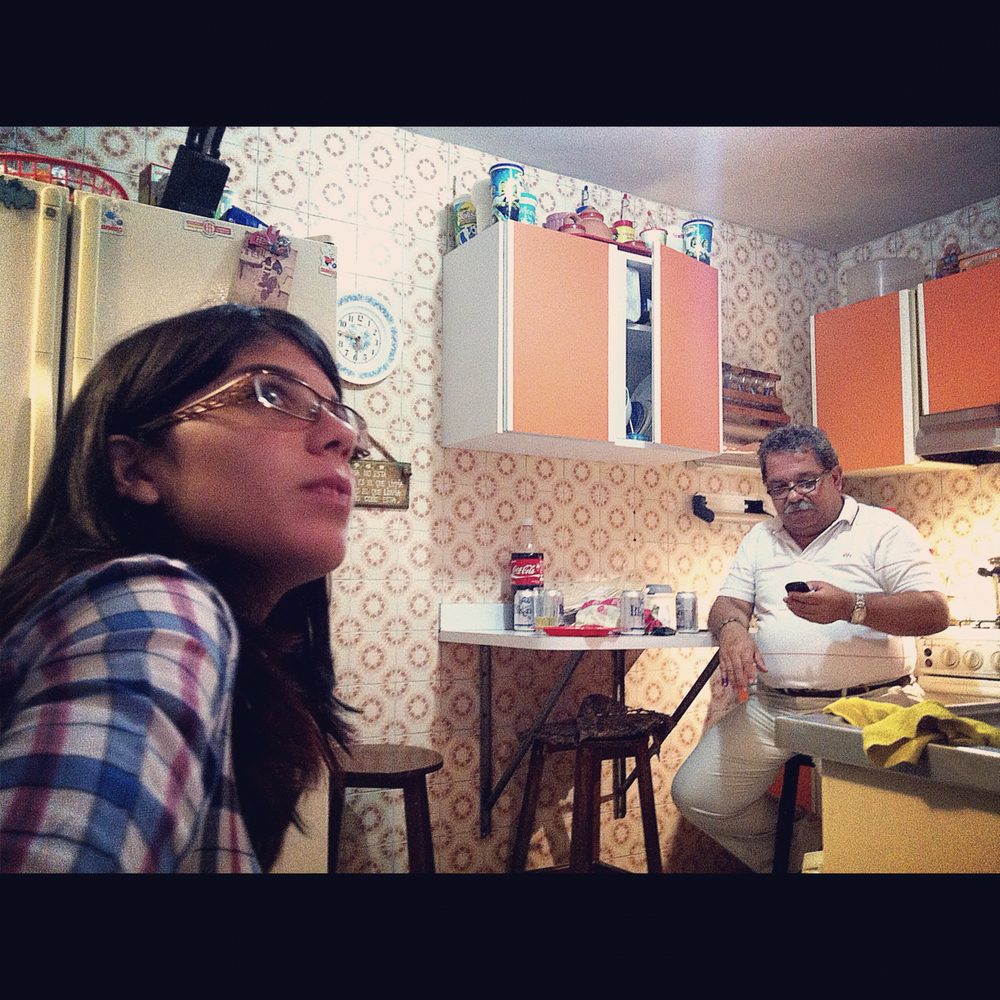 Ana and her father watch as the Venezuelan ballot counting proceeds