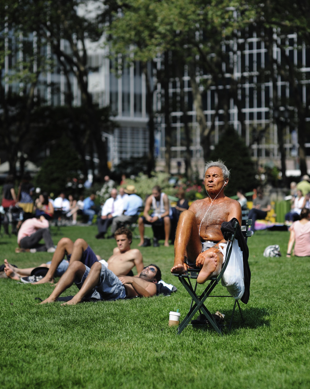 The most intensely orange colored human I've ever seen.  Bryant Park, New York