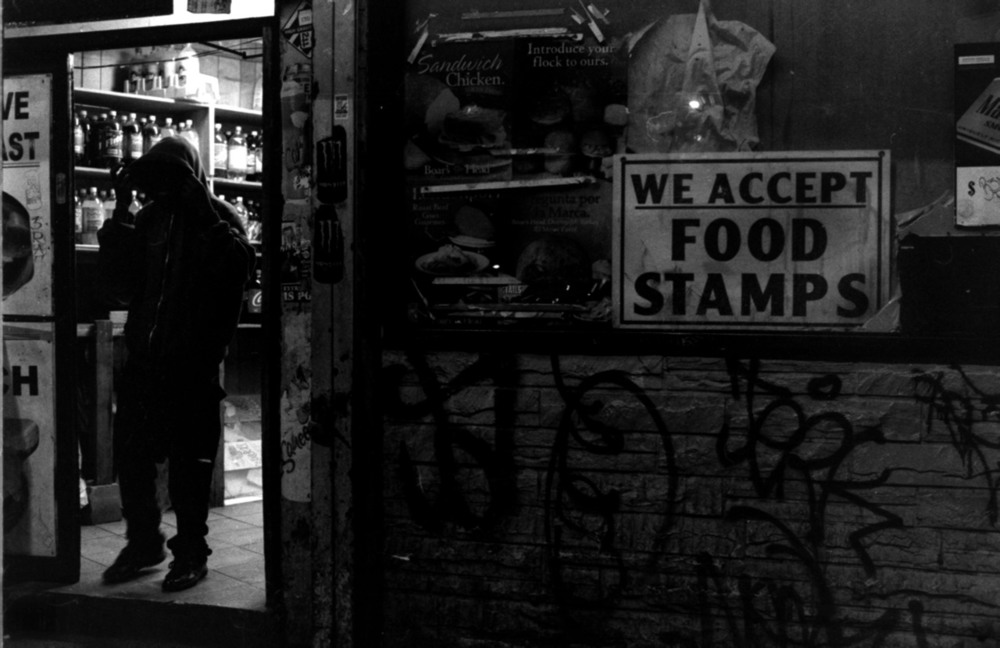 This photo does not require a location. The lower class exists across the United States. Across the world. This is a global issue and cannot be unfairly restrained to one area. Until we realize that powerful corporations, politicians, and the revolving door of which they so easily fluctuate, feed lies into societyfuelinga class war we will never improve. It is not limited to race or inequality; in fact it feeds upon it. You are left living in fear so that you may be beguiled and misled. You are told you're on a new colored level of some fucking terrorism watch, and are stripped of what is uniformly accepted as your rights. You're put on a different terrorism watch level corresponding with every color under the fucking sun. The only reason they provide for why so many parts of the world are unhappy with us is because they hate our democracy. Ignorance is the mostinfectiousdisease among us. Keep the masses fighting with each other by instigating and fueling hate for one another which compounds the fear, in order for the status quo to be sustained. The creation and sustainment of chaos andproverbialwars within a society allows those in power to stay in power. They advertise themselves as saviors. They save no one. They sow the seeds of their own destruction. No one stays at the top forever.
