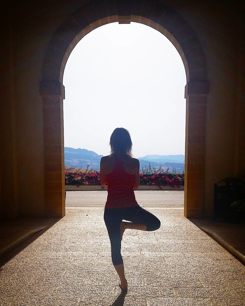 Doing morning yoga at Stemmari's estate on Sicily.