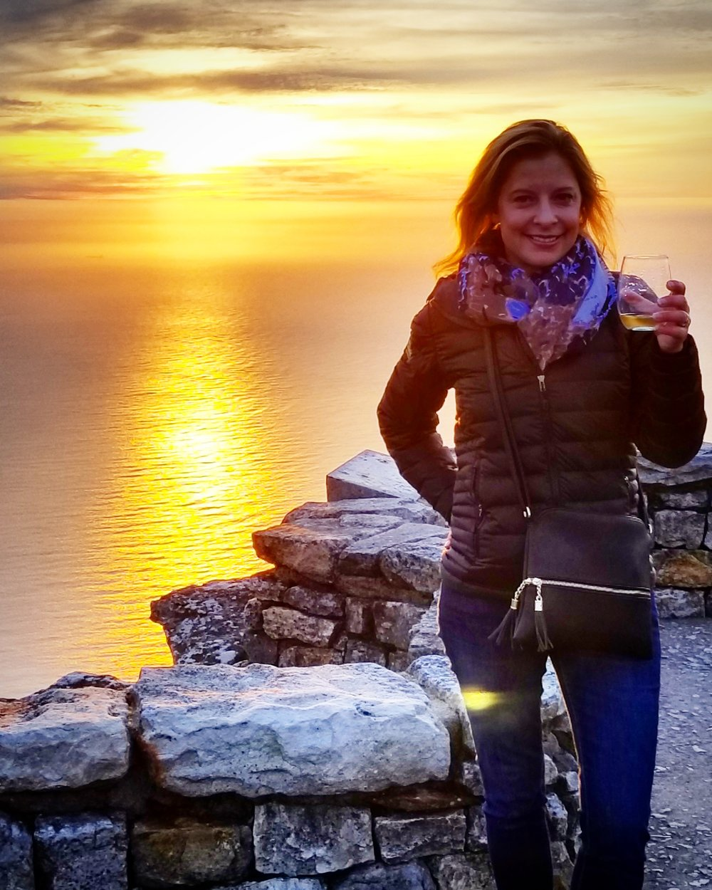 Sipping Methode Cap Classique at sunset at the top of Table Mountain in Cape Town, South Africa.