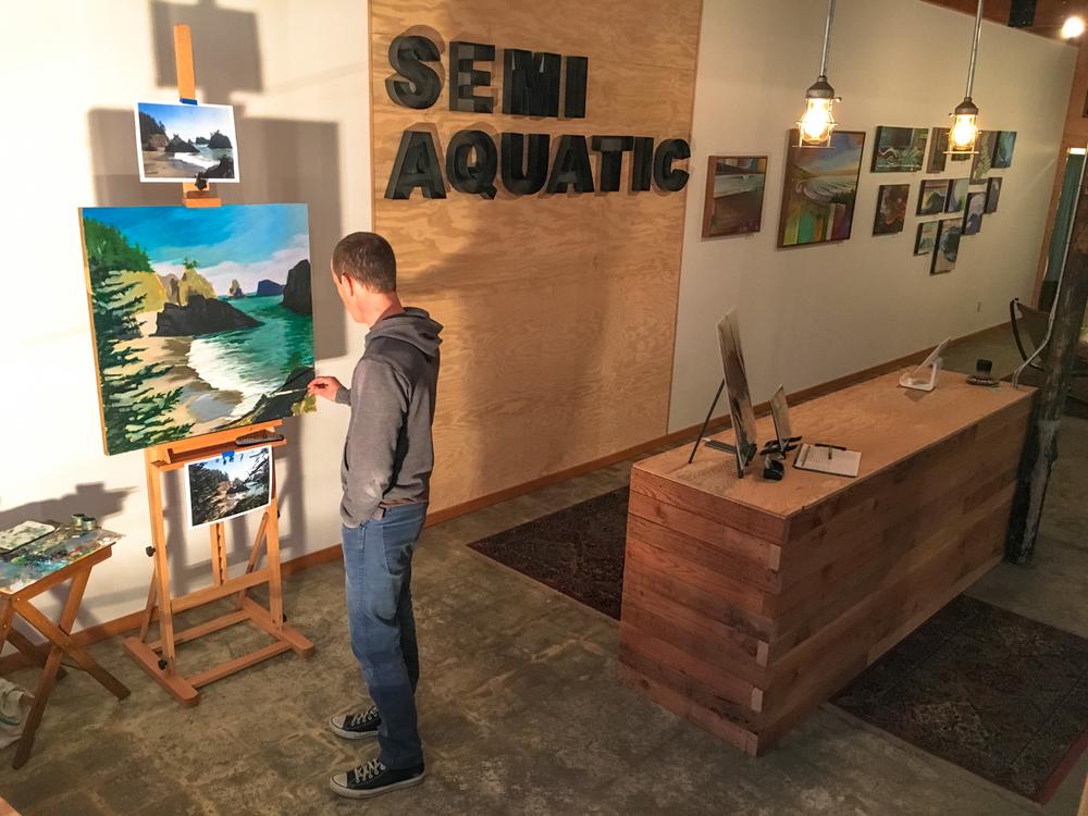 Spencer Reynolds painting Secret Beach in his new Brookings gallery, December 8, 2015. Photo: Kew.